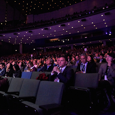 Seated attendees watching RSNA opening address